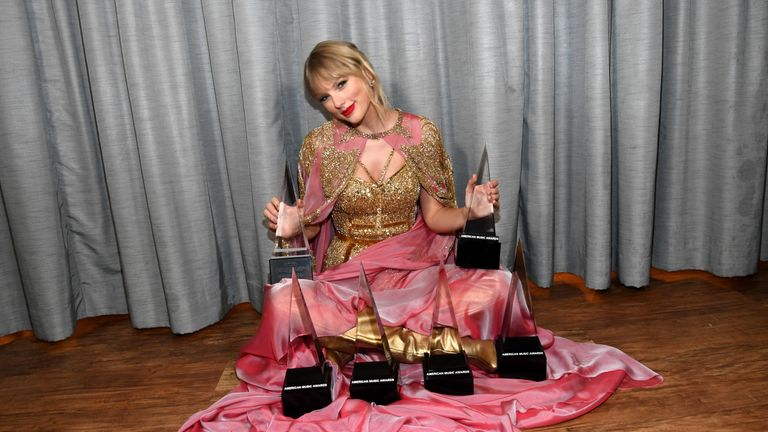 Taylor Swift with her six gongs at the American Music Awards