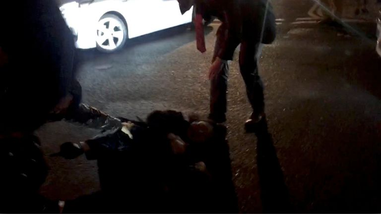Teresa Cheng falls after protesters surrounded her