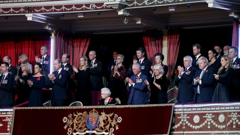 The Queen sits with members of the Royal family at the remembrance event