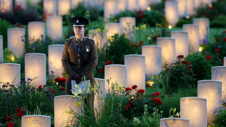 A soldier stand amongst lit war graves during a military-led vigil to commemorate the 100th anniversary of the beginning of the Battle of the Somme at the Thiepval memorial to the Missing, as part of the Commemoration of the Centenary of the Battle of the Somme at the Commonwealth War Graves Commission Thiepval Memorial in Thiepval, France, where 70,000 British and Commonwealth soldiers with no known grave are commemorated.