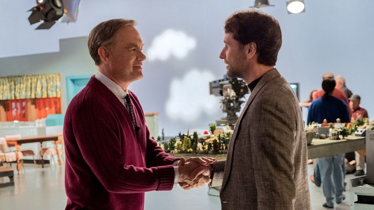 Mister Rogers (Tom Hanks) meets journalist Lloyd Vogel (Matthew Rhys) in TriStar Pictures... A BEAUTIFUL DAY IN THE NEIGHBORHOOD.