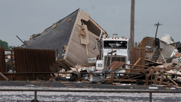 A truck sits in the rubble after a tornado struck the American Budget Value Inn,  May 26, 2019 in El Reno, Oklahoma.