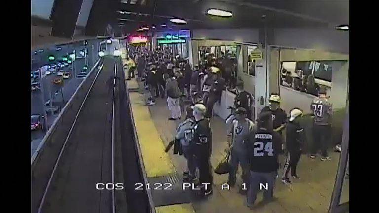 A transit employee has been commended after he rescued an intoxicated man who fell onto tracks as a train approached