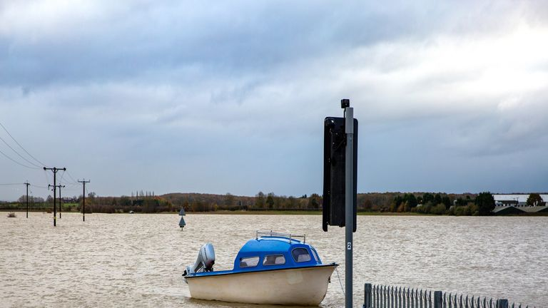 A boat by traffic lights which is normally a road in Barlings, Lincolnshire. Pic: Geoff Robinson Photography