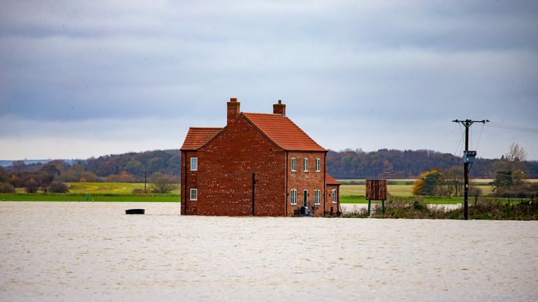 A farm house and barns surrounded by water in Barlings, Lincolnshire. Pic: Geoff Robinson Photography