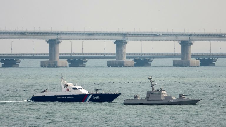A Ukrainian vessel is towed near the bridge connecting the Russian mainland with the Crimean Peninsula