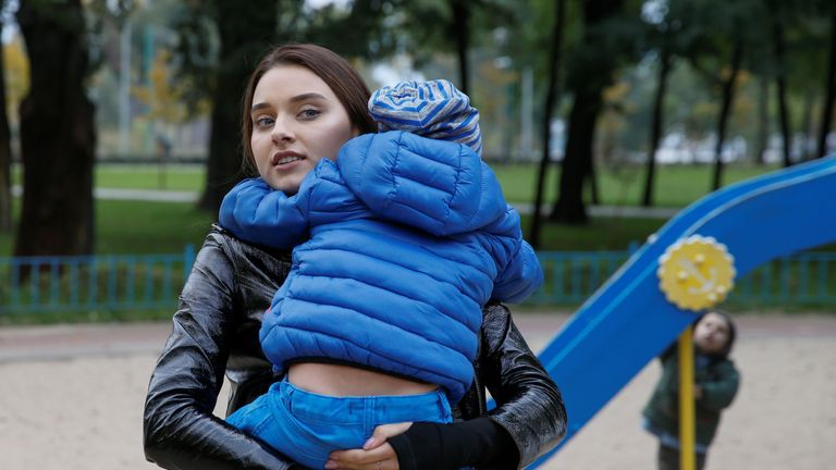 Veronika Didusenko, who was stripped of her Miss Ukraine 2018 title after the organisers discovered the model was divorced and has a child, holds her 4-year-old son before an interview with Reuters in Kiev, Ukraine October 8, 2018. Picture October 8, 2018. REUTERS/Valentyn Ogirenko