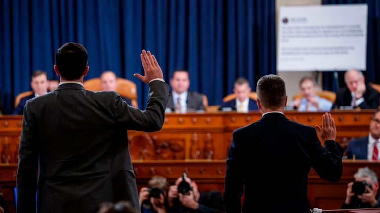 Former US Special Envoy for Ukraine, Kurt Volker (R), and top Russia and Europe adviser on President Donald Trump's National Security Council, Tim Morrison, are sworn in during the House Intelligence Committee hearing, into President Donald Trump's alleged efforts to tie US aid for Ukraine to investigations of his political opponents, on Capitol Hill in Washington, DC on November 19, 2019