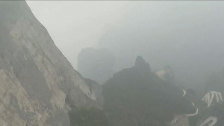 Two French wingsuit fliers, using jet-propelled wings, soared through the Tianmen cave near Zhangjiajie, central China's Hunan province