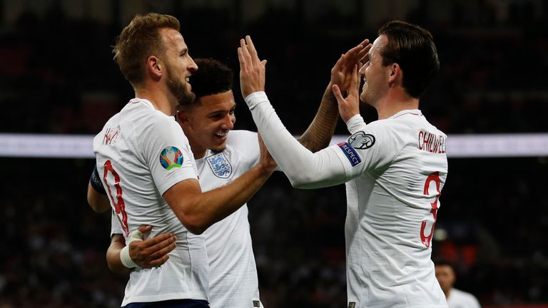 England striker Harry Kane (L) celebrates with Jadon Sancho and Ben Chilwell after his second goal against Montenegro