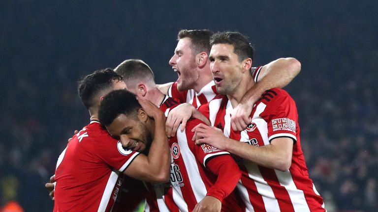 Lys Mousset celebrates with his Sheffield United team-mates after scoring against Manchester United at Bramall Lane