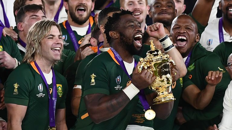 South Africa captain Siya Kolisi (C) lifts the Webb Ellis Cup as they celebrate winning the Japan 2019 Rugby World Cup final