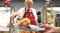 Boris Johnson serves Christmas lunch to British troops stationed in Estonia