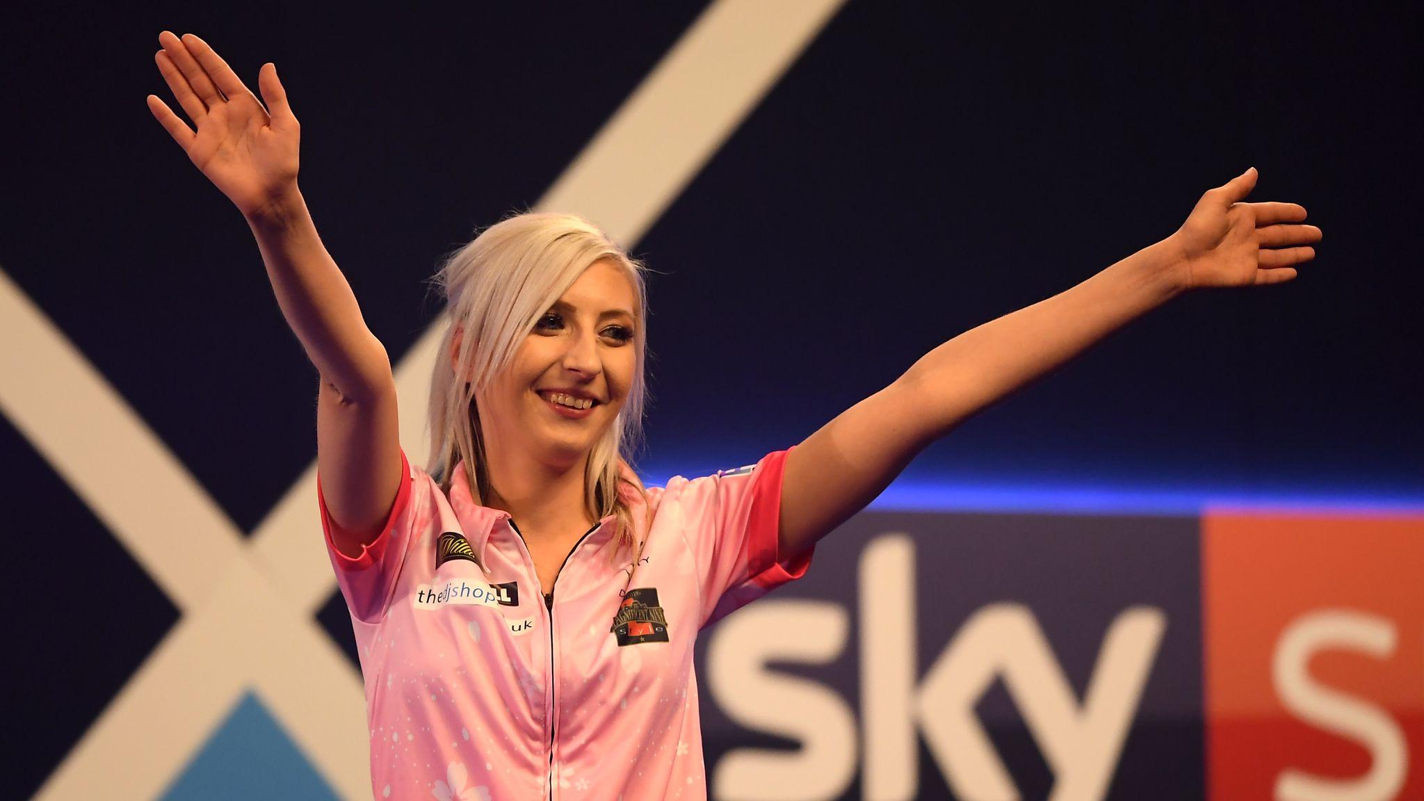 Female darts player Fallon Sherrock beats another man at World Championships