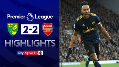Aubameyang double earns Arsenal point