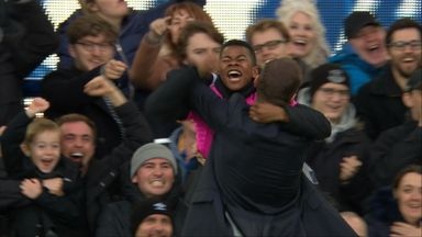 Ferguson celebrates with ball boys!
