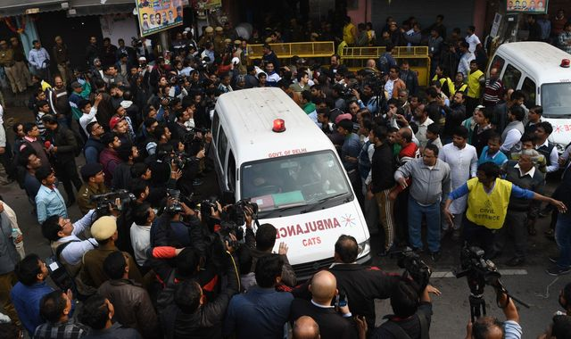 New Delhi factory fire: Relatives identify victims from photos on police phones as blaze kills 43