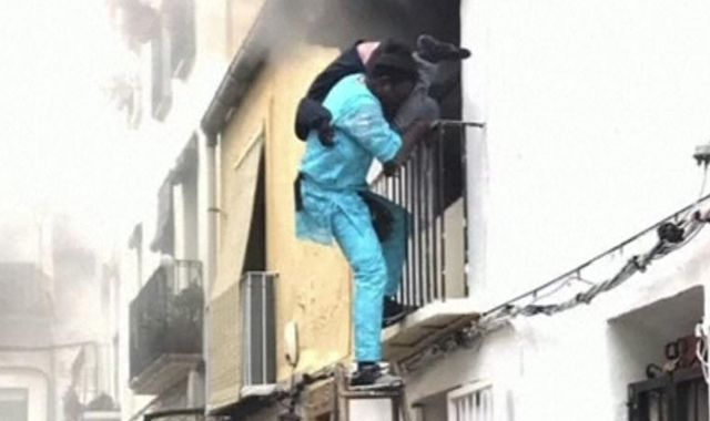 Migrant rescues disabled man from house fire in Spain