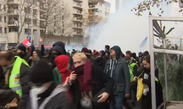 France protests: Riot police fire tear gas to break up demonstrations in Paris