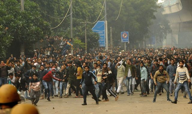 India: Police fire tear gas as protests against new citizenship law turn violent