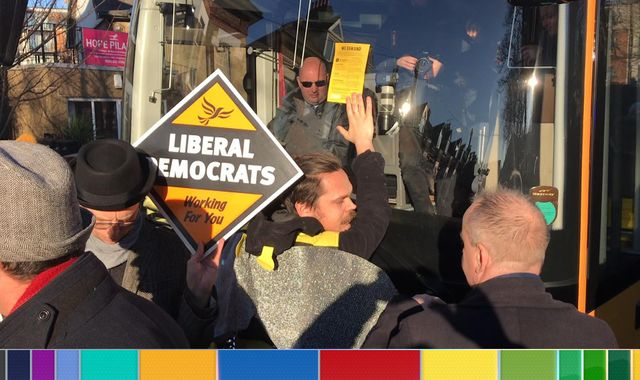General election: Extinction Rebellion protesters glue themselves to Lib Dems' electric bus
