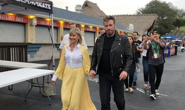 Grease stars Olivia Newton-John and John Travolta don costumes for first time in four decades