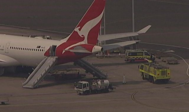 Qantas flight evacuated using slides as cabin starts to fill up with smoke