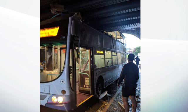 Seven injured as double-decker bus crashes into railway bridge in Swansea