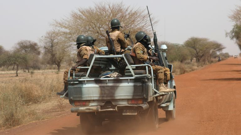 Soldiers from Burkina Faso patrol on the road of Gorgadji in sahel area, Burkina Faso March 3, 2019. Picture taken March 3, 2019. REUTERS/Luc Gnago