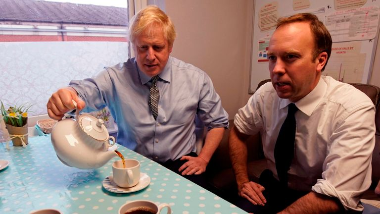 Britain's Health and Social Care Secretary Matt Hancock (R) and Britain's Prime Minister Boris Johnson have tea with staff members during a Conservative Party general election campaign visit to Bassetlaw District General Hospital in Worksop, central England on November 22, 2019. - Britain will go to the polls on December 12, 2019 to vote in a pre-Christmas general election. (Photo by Christopher Furlong / POOL / AFP) (Photo by CHRISTOPHER FURLONG/POOL/AFP via Getty Images)