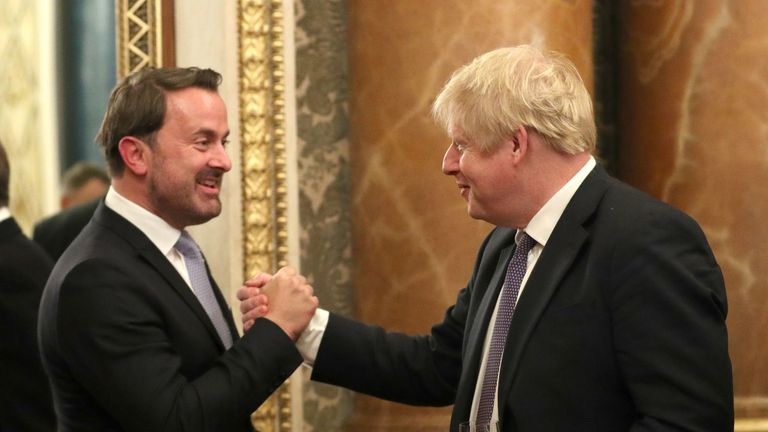 Britain's Prime Minister Boris Johnson (R) greets his Luxembourg counterpart Xavier Bettel at Buckingham Palace in central London on December 3, 2019, to attend reception hosted by Britain's Queen Elizabeth II ahead of the NATO alliance summit. - NATO leaders gather Tuesday for a summit to mark the alliance's 70th anniversary but with leaders feuding and name-calling over money and strategy, the mood is far from festive. (Photo by Yui Mok / POOL / AFP) (Photo by YUI MOK/POOL/AFP via Getty Images)