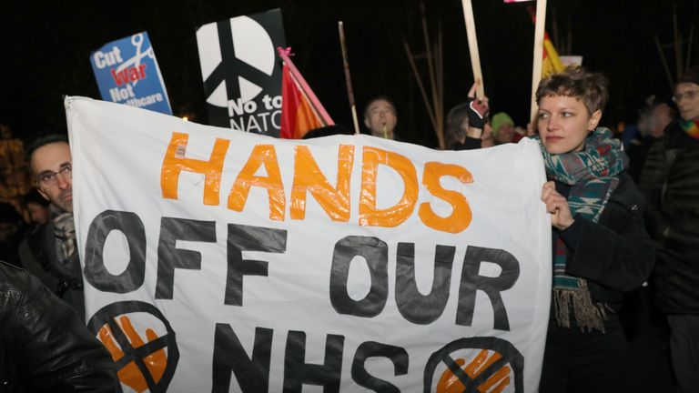 "NHS nurses and doctors protest outside Buckimngham Palace , London, during a ""Hands off our NHS"" protest against Donald Trump, who is in the capital as Nato leaders gather to mark 70 years of the alliance."
