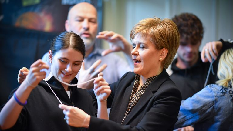 "PERTH, SCOTLAND - DECEMBER 03: Nicola Sturgeon plays a game with string during a general election campaign visit to Perth and District YMCA, with Pete Wishart, SNP Candidate for Perth and North Perthshire on December 3, 2019 in Perth, Scotland. The First Minister warned that Scotland's NHS is ""on the line"" if Boris Johnson agrees to the Donald Trump's demands in a desperate attempt to agree a post-Brexit trade deal. (Photo by Jeff J Mitchell/Getty Images)"