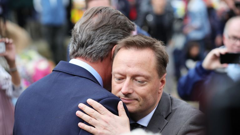 BIRSTALL, UNITED KINGDOM - JUNE 17:  (L-R) Prime Minister David Cameron embraces Jason McCartney MP for Colne Valley in West Yorkshire as they pay their respects near to the scene of the murder of Jo Cox, 41, Labour MP for Batley and Spen, who was shot and stabbed yesterday at her constituency surgery, on June 17, 2016 in Birstall, United Kingdom. The Labour MP for Batley and Spen was about to hold her weekly constituency surgery in Birstall Library yesterday on June 16, 2016, when she was shot and stabbed in the street. A 52-year old man is being held in Police custody in connection with the death.  (Photo by Christopher Furlong/Getty Images)