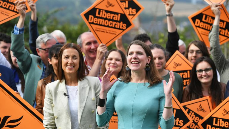 Newly-elected Liberal Democrat leader Jo Swinson (right) and Welsh Liberal Democrat leader Jane Dodds (left) arrive at the Castle Hotel in Brecon, Wales, after the Liberal Democrats have won the Brecon and Radnorshire by-election.