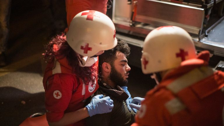 BEIRUT, LEBANON - DECEMBER 15: Red Cross medics tend to an unconscious protester after riot police used tear gas and water cannon to disperse anti-government demonstrators as they clashed for the second day in a row, in Martyr's Square on December 15, 2019 in Beirut, Lebanon. The clashes came ahead of an expected nomination Monday for previous Prime Minister Saad Hariri to resume his post with protesters rejecting this move. Since October 17th protests have been held across the country against a corrupt ruling class, a sectarian political system and poor living conditions. Saad Hariri resigned as prime minister on October 29, creating a governmental vacuum. (Photo by Sam Tarling/Getty Images)