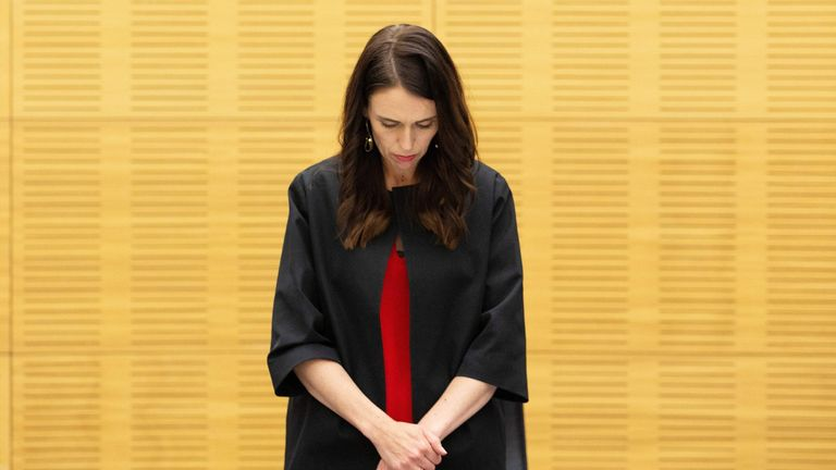 New Zealand Prime Minister Jacinda Ardern stands with her cabinet as they observe a minute's silence in respect for victims of the December 9 White Island volcanic eruption, at Parliament in Wellington on December 16, 2019. - The names of four more people killed in an eruption on New Zealand's most active volcano were released on December 16, as the South Pacific nation paused for a minute's silence at 2:11pm (0111 GMT) -- precisely a week since the eruption -- in tribute to those affected. (Photo by Hagen Hopkins / POOL / AFP) (Photo by HAGEN HOPKINS/POOL/AFP via Getty Images)