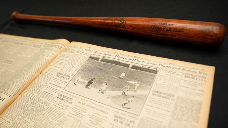 Babe Ruth's 500th home run bat is shown next to a copy of the next days New York Times before it goes up for auction by SCP Auctions in Laguna Niguel, California, U.S., November 25, 2019. Picture taken November 25, 2019.    REUTERS/Mike Blake
