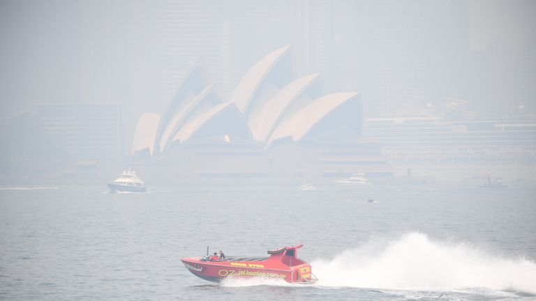 SYDNEY, AUSTRALIA - DECEMBER 19: A tourist boat rides on the Harbour in thick smoke on December 19, 2019 in Sydney, Australia. NSW Premier Gladys Berejiklian has declared a state of emergency for the next seven days with ongoing dangerous fire conditions and almost 100 bushfires burning across the state. It's the second state of emergency declared in NSW since the start of the bushfire season. (Photo by James D. Morgan/Getty Images)
