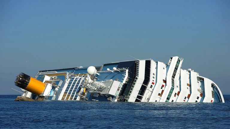GIGLIO PORTO, ITALY - JANUARY 18:  Cruise ship Costa Concordia lies stricken off the shore of the island of Giglio at Giglio Porto on January 18, 2012 in Giglio Porto, Italy. The official death toll is now 11, with a further 24 people still  missing. The rescue operation was temporarily suspended earlier due to the ship  moving as it slowly sinks further into the sea.  (Photo by Tullio M. Puglia/Getty Images)