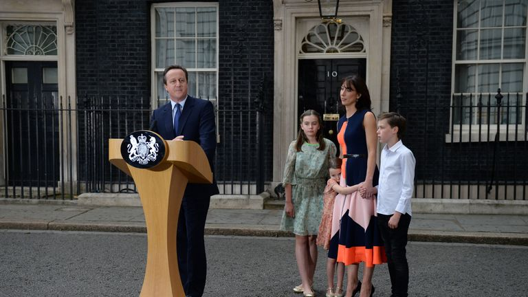 Outgoing British prime minister David Cameron speaks beside (L-R) his daughter Nancy Gwen, daughter Florence Rose Endellion, his wife Samantha Cameron and son Arthur Elwen outside 10 Downing Street in central London on July 13, 2016 before going to Buckingham Palace to tender his resignation to Queen Elizabeth II.  Outgoing British prime minister David Cameron urged his successor Theresa May on Wednesday to maintain close ties with the EU even while negotiating to leave it, as he paid a fond farewell to MPs hours before leaving office. Cameron will tender his resignation on July 13 to Queen Elizabeth II at Buckingham Palace, after which the monarch will task the new leader of the Conservative Party Theresa May with forming a government.  / AFP / OLI SCARFF        (Photo credit should read OLI SCARFF/AFP via Getty Images)