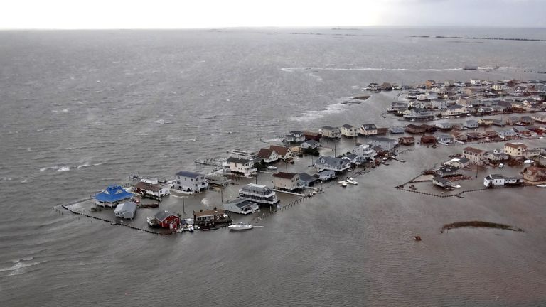 """TUCKERTON, NJ - OCTOBER 30:  In this handout image provided by the U.S. Coast Guard, homes are flooded after Hurricane Sandy made landfall on the southern New Jersey coastline October 30, 2012 in Tuckerton, New Jersey. The storm has claimed many lives in the United States and has caused massive flooding across much of the Atlantic seaboard. U.S. President Barack Obama has declared the situation a """"major disaster"""" for large areas of the U.S. east coast, including New York City, with widespread power outages and significant flooding in parts of the city.  (Photo by U.S. Coast Guard via Getty Images)"""