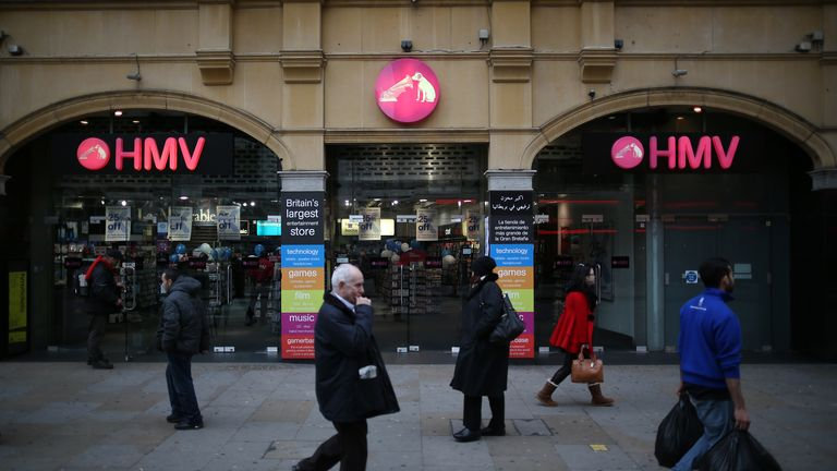 LONDON, ENGLAND - JANUARY 15:  People walk past the HMV music and video shop in Piccadilly on January 15, 2013 in London, England. Management have announced that administrators have been called in which may put the 4350 staff at risk. HMV was founded in 1921  has 239 stores in the UK and the Republic of Ireland and has struggled to compete against online retailers.  (Photo by Peter Macdiarmid/Getty Images)