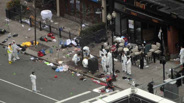 BOSTON - APRIL 16:  Investigators in white jumpsuits work the crime scene on Boylston Street following yesterday's bomb attack at the Boston Marathon April 16, 2013 in Boston, Massachusetts. Security is tight in the City of Boston following yesterday's two bomb explosions near the finish line of the Boston Marathon, that killed three people and wounding hundreds more.  (Photo by Darren McCollester/Getty Images)