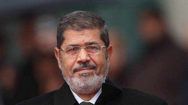 BERLIN, GERMANY - JANUARY 30:  Egyptian President Mohamed Mursi arrives at the Chancellery to meet with German Chancellor Angela Merkel on January 30, 2013 in Berlin, Germany. Mursi has come to Berlin despite the ongoing violent protests in recent days in cities across Egypt that have left at least 50 people dead. Mursi is in Berlin to seek both political and financial support from Germany.  (Photo by Sean Gallup/Getty Images)