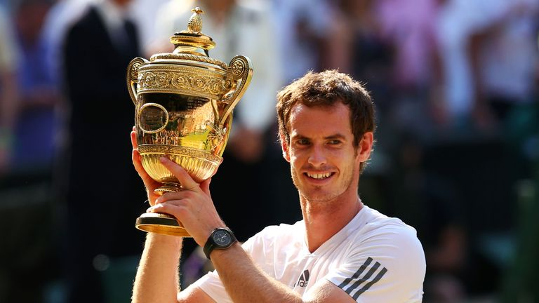LONDON, ENGLAND - JULY 07:  Andy Murray of Great Britain poses with the Gentlemen's Singles Trophy following his victory in the Gentlemen's Singles Final match against Novak Djokovic of Serbia on day thirteen of the Wimbledon Lawn Tennis Championships at the All England Lawn Tennis and Croquet Club on July 7, 2013 in London, England.  (Photo by Julian Finney/Getty Images)