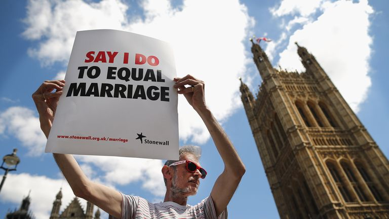 LONDON, ENGLAND - JUNE 03:  A proponent of same sex marriage protest outside the Houses of Parliament on June 3, 2013 in London, England.  A government bill allowing same sex marriage in England and Wales was passed in the House of Commons last month, despite the opposition of 133 Conservative MP's. The bill will be debated later today in the House of Lords.  (Photo by Dan Kitwood/Getty Images)