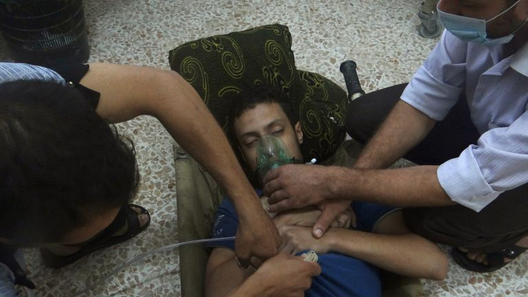 A man, affected by what activists say is nerve gas, breathes through an oxygen mask in the Damascus suburbs of Jesreen August 21, 2013. Syrian activists accused President Bashar al-Assad's forces of launching a gas attack that killed nearly 500 people on Wednesday, in what would, if confirmed, be by far the worst reported use of chemical arms in the two-year-old civil war. The Syrian armed forces strongly denied using chemical weapons. Syrian state television said the accusations were fabricated to distract a team of U.N. chemical weapons experts which arrived three days ago. REUTERS/Ammar Dar (SYRIA - Tags: CONFLICT POLITICS CIVIL UNREST)