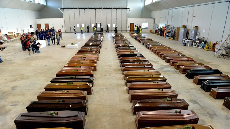 LAMPEDUSA, ITALY - OCTOBER 05:  Coffins of some of the African migrants killed in a shipwreck off the Italian coast sit in a hangar at the Lampedusa airport on October 5, 2013 in Lampedusa, Italy. The search for bodies continues off the coast of Southern Italy as the death toll of African migrants who drowned as they tried to reach the island of Lampedusa is expected to reach over 300 people. The tragedy has brought fresh questions over the thousands of asylum seekers that arrive into Europe by boat each year.  (Photo by Tullio M. Puglia/Getty Images)
