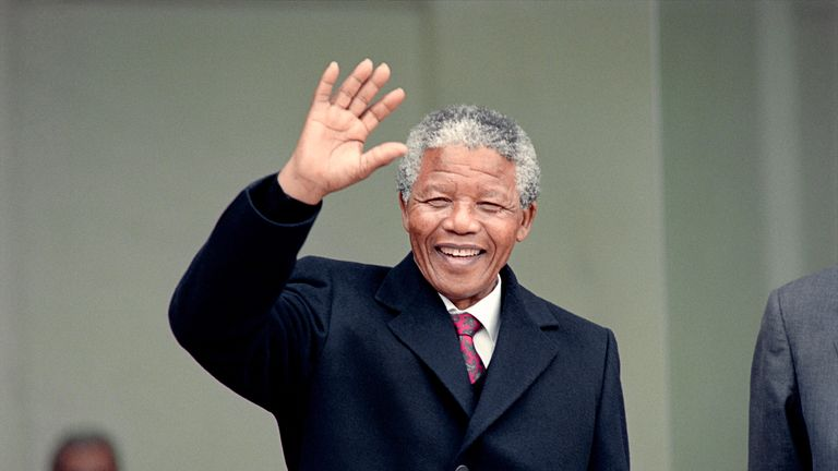 South African anti-apartheid leader and African National Congress (ANC) member Nelson Mandela waves to the press as he arrives at the Elysee Palace, 07 June 1990, in Paris, to have talks with French president Francois Mitterrand. Nelson Mandela, who was released from jail on 11 February 1990, is in Paris for a two-day official visit.        (Photo credit should read MICHEL CLEMENT,DANIEL JANIN/AFP via Getty Images)